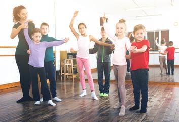 Little boys and girls having dancing