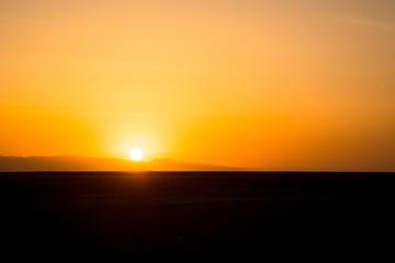 Sunset or sunrise over the Sahara Desert