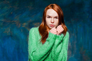 young cold redhead girl