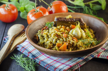 Pilaf on a platter with meat and spices