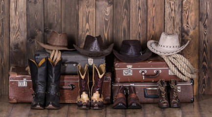 Old suitcases, hats and cowboy shoes