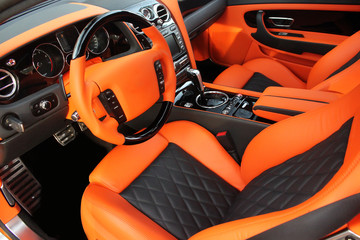 View of the interior of a modern automobile showing the dashboard. Tuning. Orange luxury car. Supercar. Orange. England. Tuning. Karbon. Europe. Car. Salon