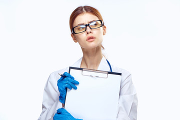 Young beautiful woman on white isolated background holds documents sick, medicine, doctor