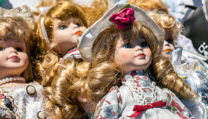 close-up of retro and vintage porcelain dolls for collection