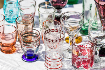 50s glasses in different colors and shapes at garage sal