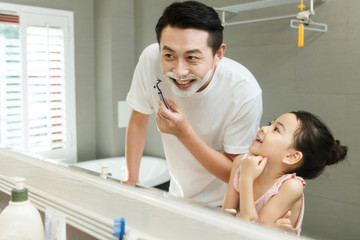 Father and daughter in bathroom