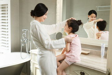 Mother and daughter in bathroom