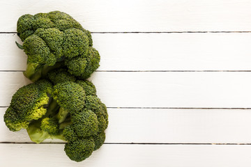 Broccoli on white boards. view from above. A great place for text. Rustic