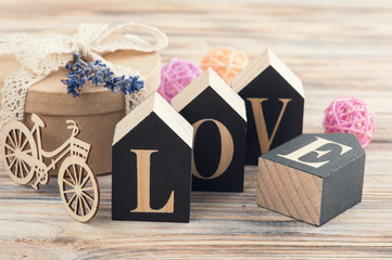 Arrangement with gift, lavender, wooden letters Love