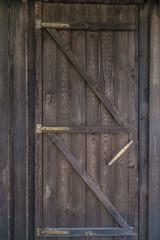 Countryside aged old farm barn door closeup