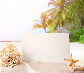 Blank card, starfish and coral on sand against color background. Concept of travel and vacation