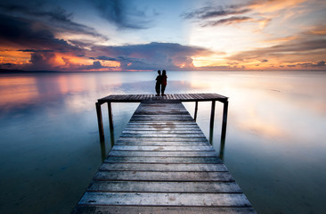 View of beautiful sunset with wooden jetty. image contain soft focus due to long expose.