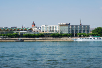 MAINZ, GERMANY - JUL 09th, 2017: Luxury Hilton Hotel next to the Rhine german Rhein. Outside view from the opposite river side. Hilton Hotels Resorts is an international chain of full service hotels