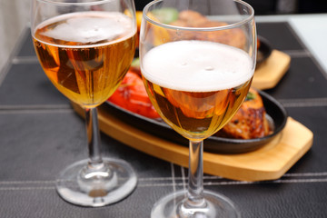 two beer glass and food background