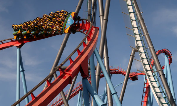 People ride in the 'Dragon Khan' roller coaster at PortAventura resort, south of Barcelona