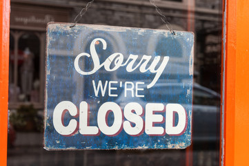 Sorry we're closed sign in a store window