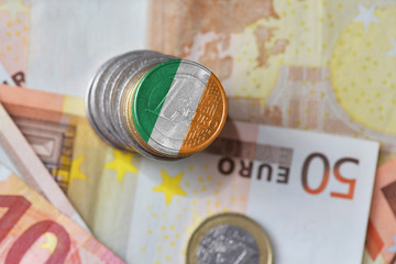euro coin with national flag of ireland on the euro money banknotes background.