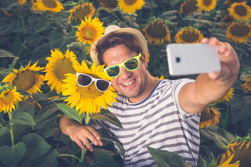 Selfie in sunflower field