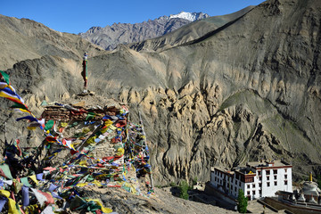 Tourist during expedition in the mountains Ladakh is admiring the beautiful Karakorum panorama in the vicinity of the Lamayuru town.