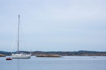 Gummibåten och seglaren