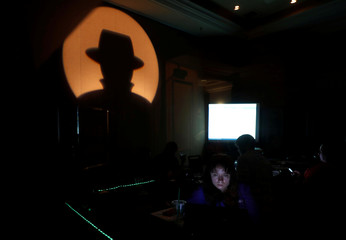A woman works in a network operations center during the Black Hat information security conference in Las Vegas