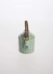 tea pot or ceramic teapot on background.