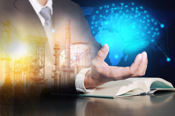 businessman hold virtual glowing blue brain, oil fuel, Electric generating factory, plant and sunset on glowing line world map as business, control, technology, future, industrial and energy concept.