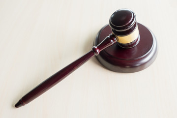 a gavel on a wooden brown desktop, Law, lawyer and justice concept