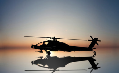 apache helicopter on the sun set