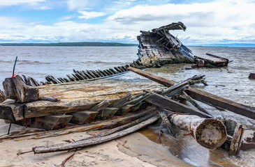 Baie-Saint-Paul in Quebec, Canada shipwreck in water with waves