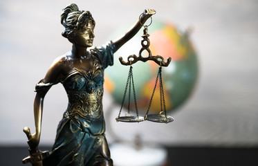 Symbols for balance and power in law and court, selected focus, narrow depth of field