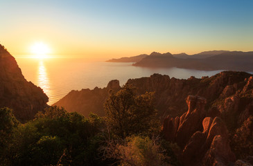 Fotomurales - Cliffs and coast of a Mediterranean island during sunset. Calanche de Piana and the Golf of Porto, Corsica, France.