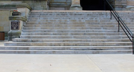 The cement steps going up to the building.
