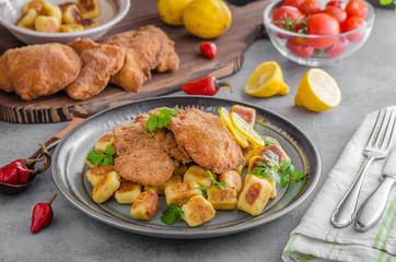 Schnitzel original with lemon and gnocchi fried