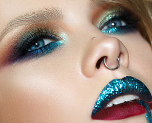 Close up portrait of girl with fashion colorful make up