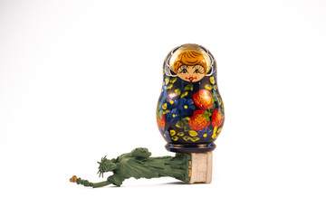 Russian babushka doll standing on top of the fallen Statue of Liberty