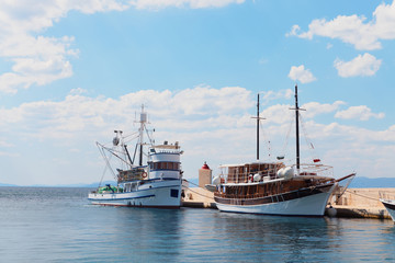 Two ships in the harbor of a small town - Croatia, island Brac
