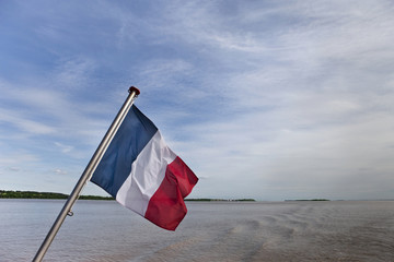 French flag on a river