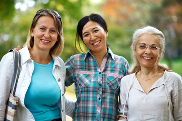 Three mature ladies smiling