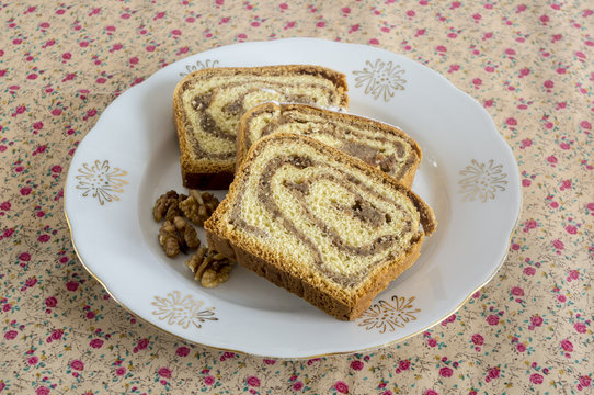 Traditional Slovenian potica, a festive cake filled with walnut filling.