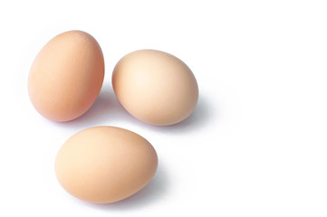 Three uncooked eggs isolated on white