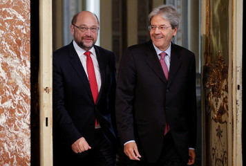 Italian Prime Minister Gentiloni and Germany's Social Democratic Party candidate for chancellor Schulz arrive for a news conference at Chigi Palace in Rome