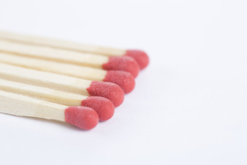 A bunch of matches isolated on white. Closeup.
