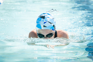 Young Female Swimming Breaststroke