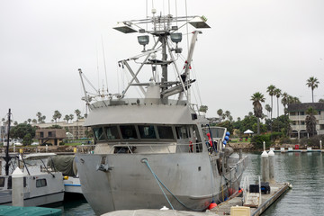 Sea fishing boat at the dock in Oxnard marina Ventura county Southern California Pacific coast