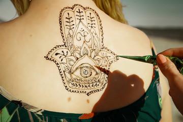 henna tattoo mehendy painted on back