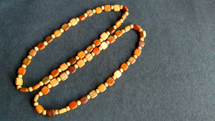 A pair of wooden beads