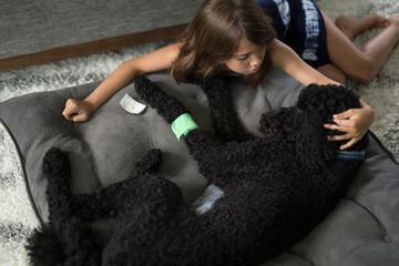 Girl with sick dog
