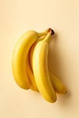 Bananas on a yellow background. Exotic fruit viewed from above. Top view.