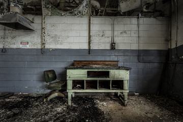 Desk and chair in an abandoned factory